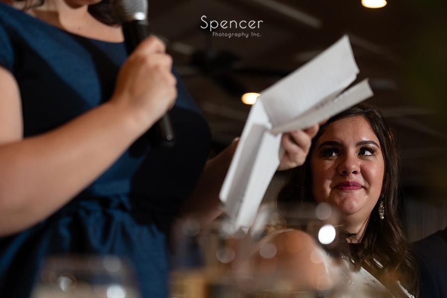 bride watching maid of honor speech