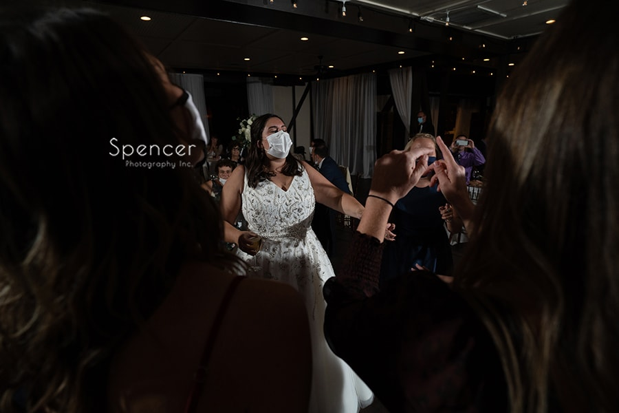 bride dancing with bridesmaids at her wedding reception