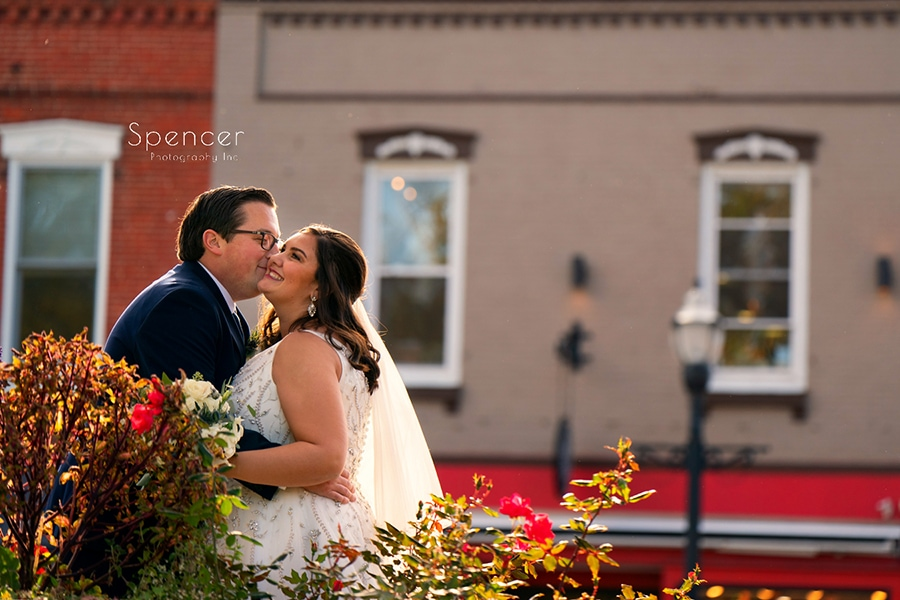 groom kissing bride after wedding in downtown Chagrin Falls