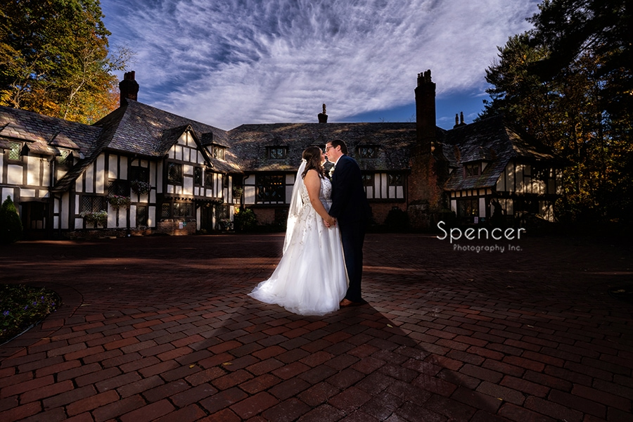 bride kissing groom in wedding picture at The Club at Hillbrook