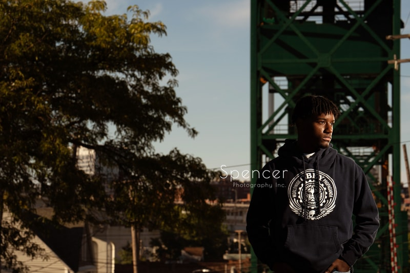 senior picture in front of Cleveland bridge