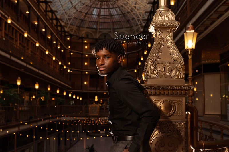 senior picture on steps of Cleveland Arcade