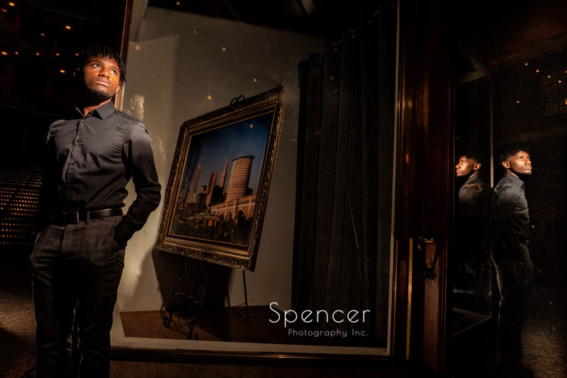 senior picture with reflections in Cleveland Arcade