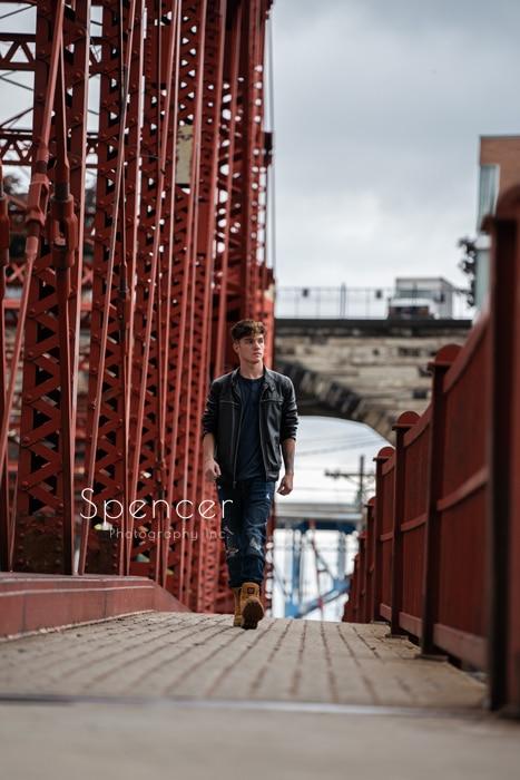 high school senior walking over cleveland bridge