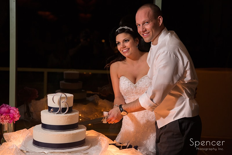 bride and groom cutting wedding cake at Troon North