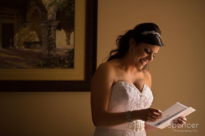 bride reading letter from groom before her wedding in Scottsdale