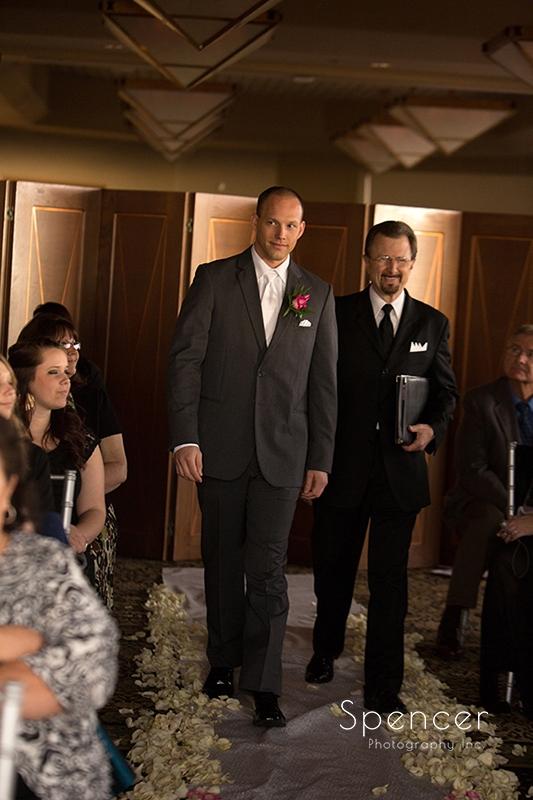 Troon north groom walking down aisle