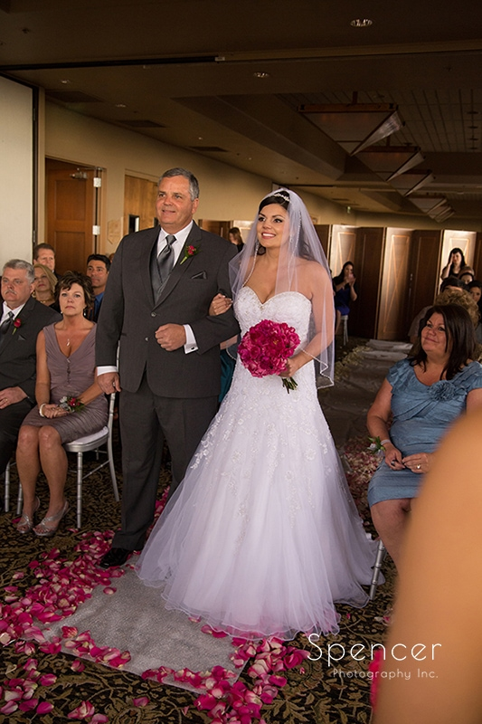 bride walking down aisle at her wedding ceremony in Scottsdale