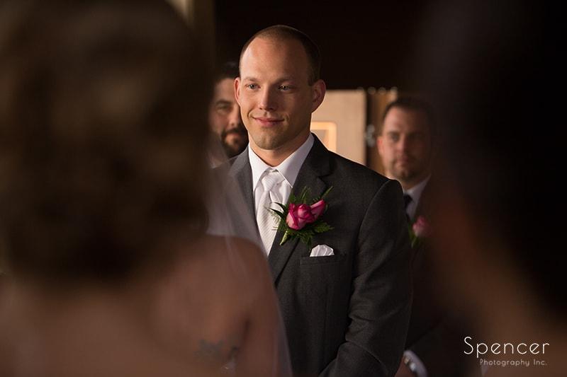 groom looking at bride during ceremony in Scottsdale