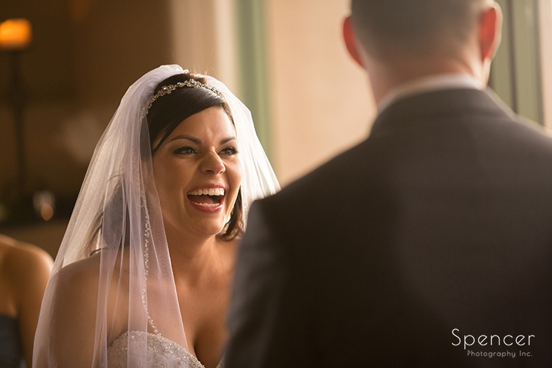 bride laughing during wedding ceremony at Troon North Golf Club