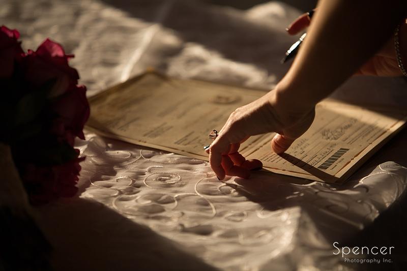 bride signing wedding license in Scottsdale