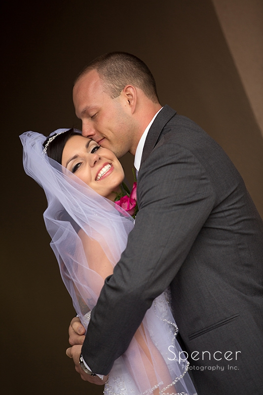 groom kissing bride at Troon North