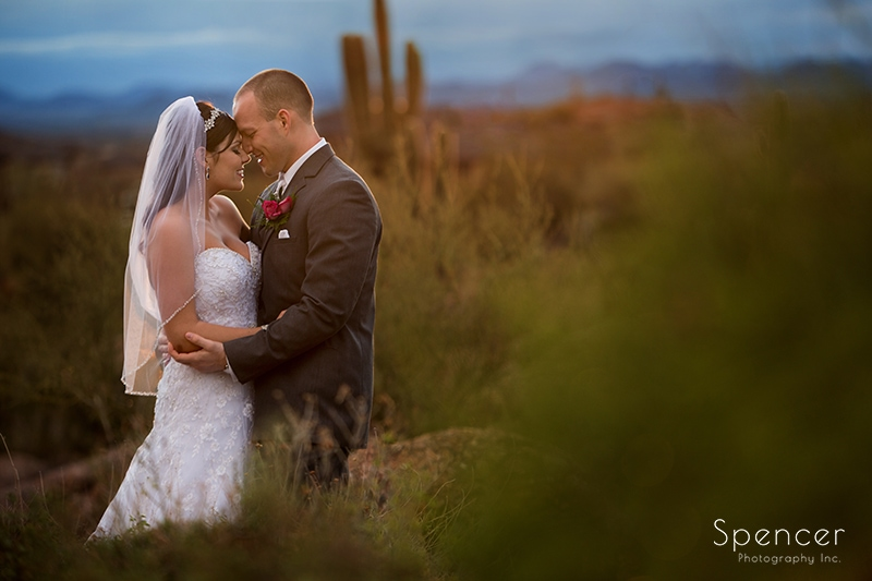 bride and groom hugging outside wedding reception at Troon North
