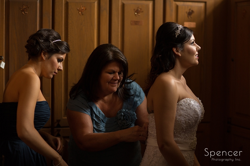 mom helping bride with wedding dress at Troon North Scottsdale