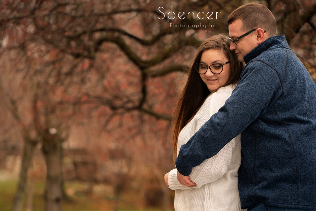 couple hugging and smiling in engagement pictures at Cleveland Museum of Art