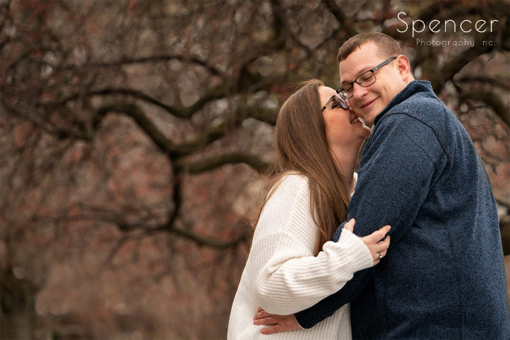 man and woman laughing during engagement pictures at Cleveland Museum of Art