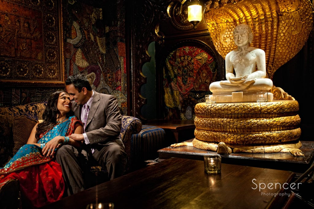 Indian couple hugging in engagement picture at House of Blues