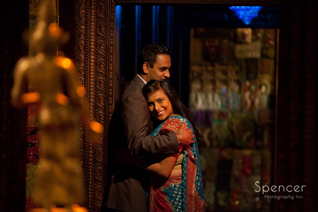 Indian couple hugging in hallway at House of Blues