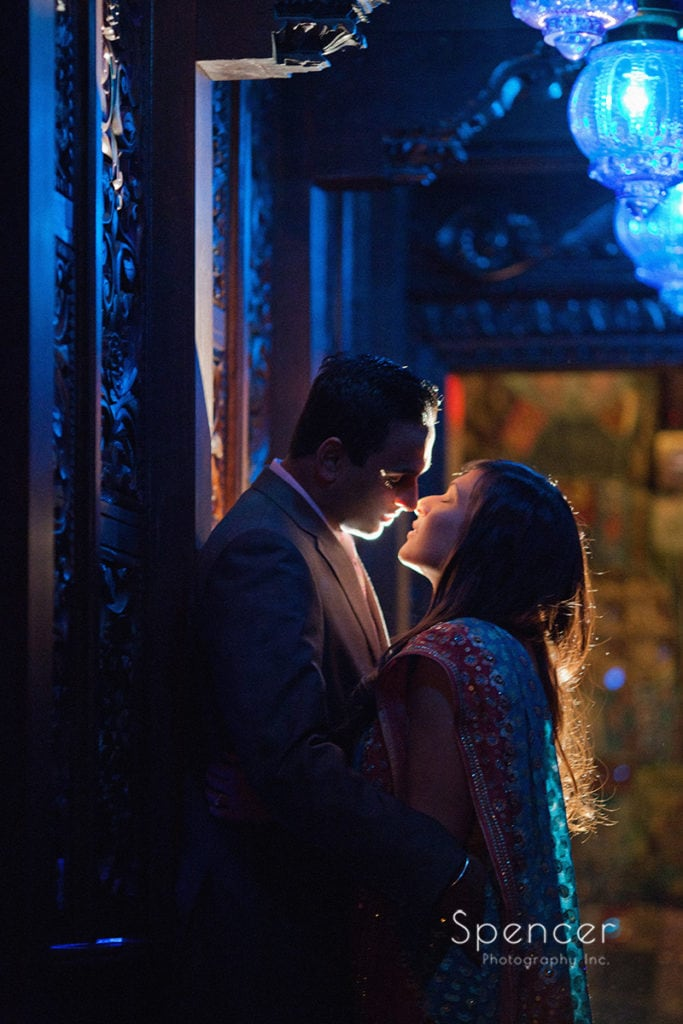 Indian couple kissing in engagement picture at House of Blues