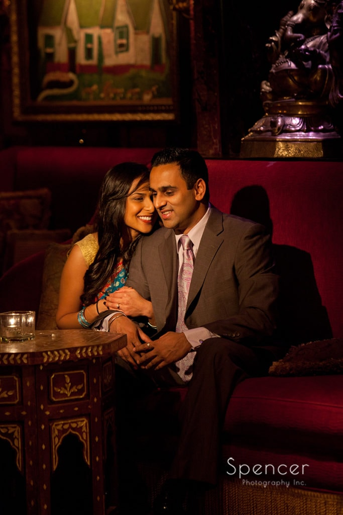 Indian couple sitting at table during engagement pictures at house of blues