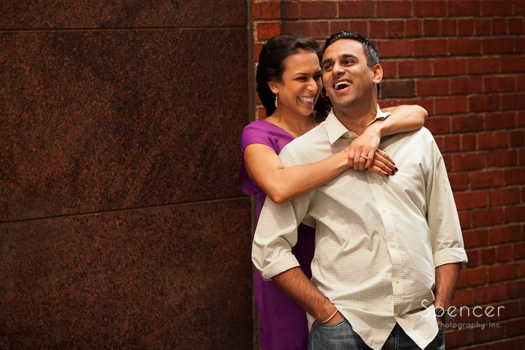 couple laughing during engagement pictures in downtown Cleveland