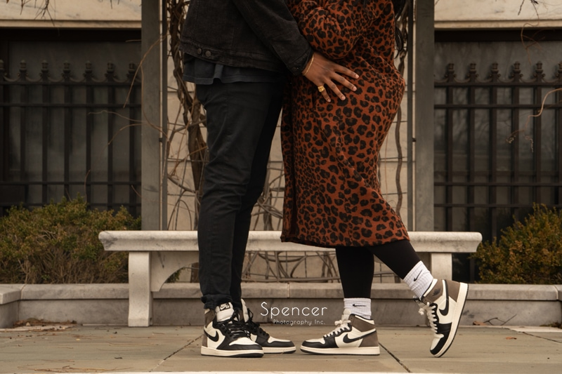 couple showing off their shoes in front of Cleveland Museum of Art