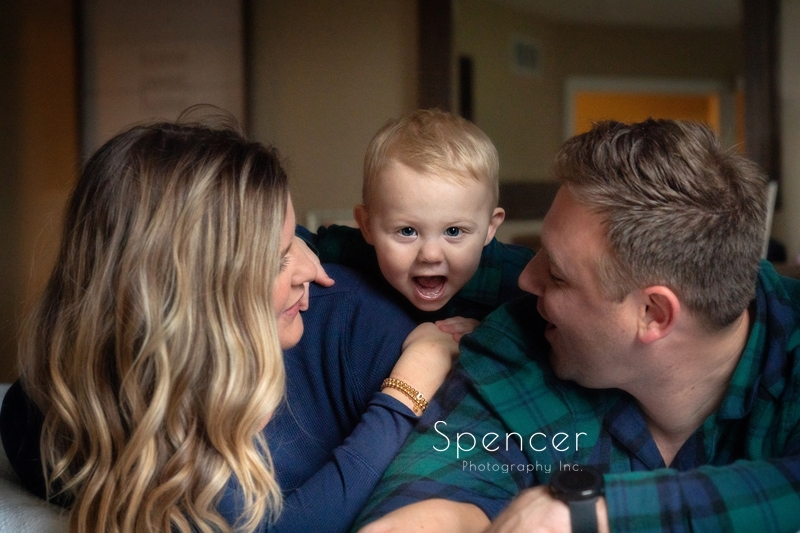 toddler laughing in family pictures in Cleveland