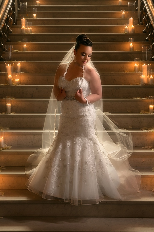 traditional wedding picture of bride on stairs of union club of Cleveland
