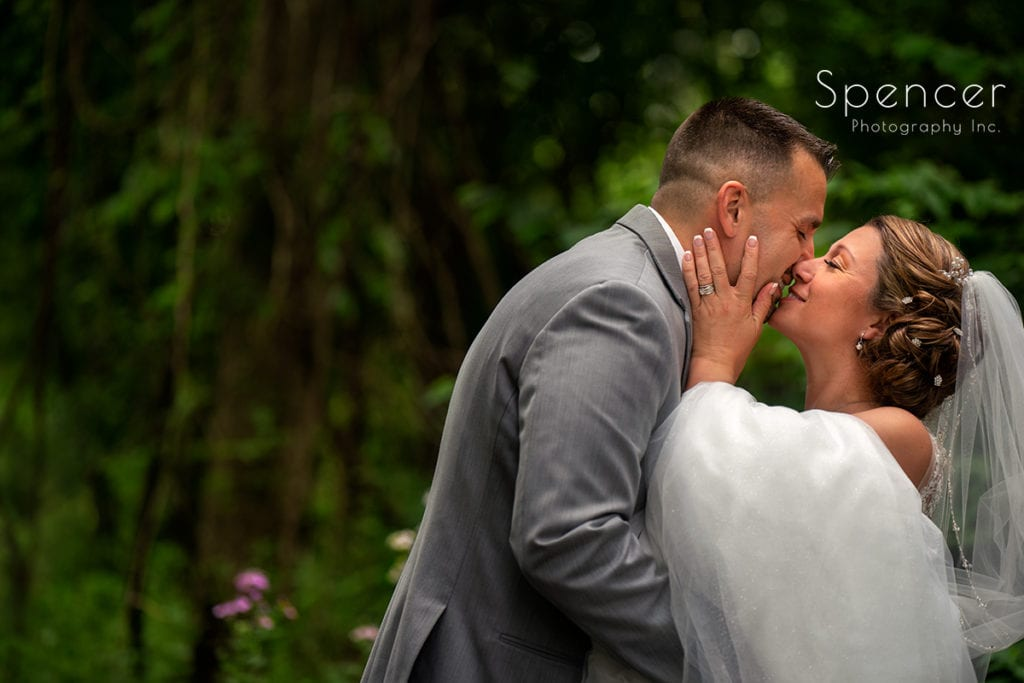 bride and groom kissing in woods in Beaver Falls PA