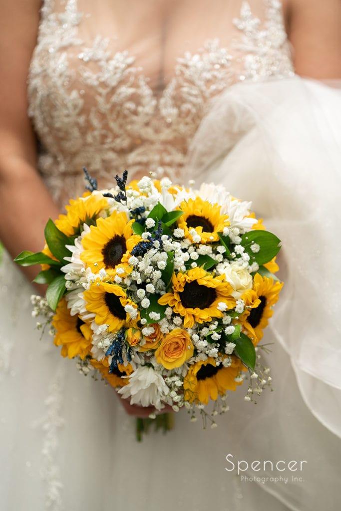 bride showing off wedding bouquet