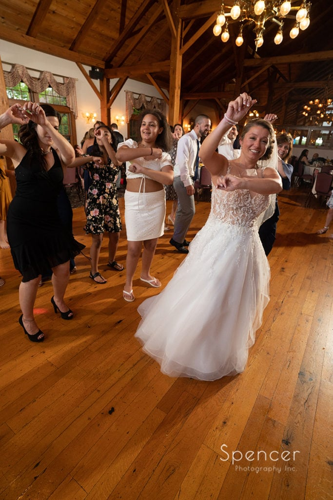bride dancing at her wedding reception at Rolling Acres Golf Course
