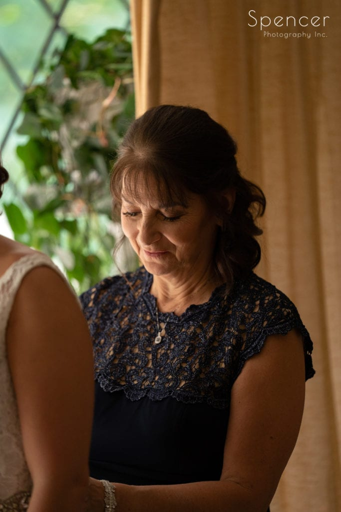 mom helping bride with dress at O'Neil House