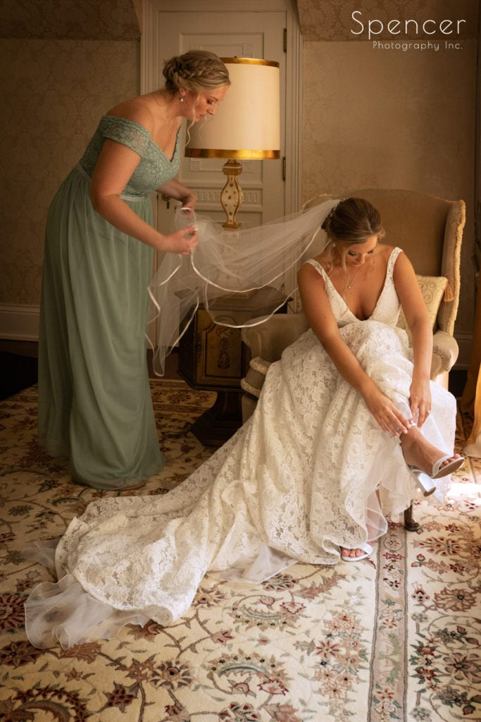 bride putting on her wedding shoes at O'Neil House