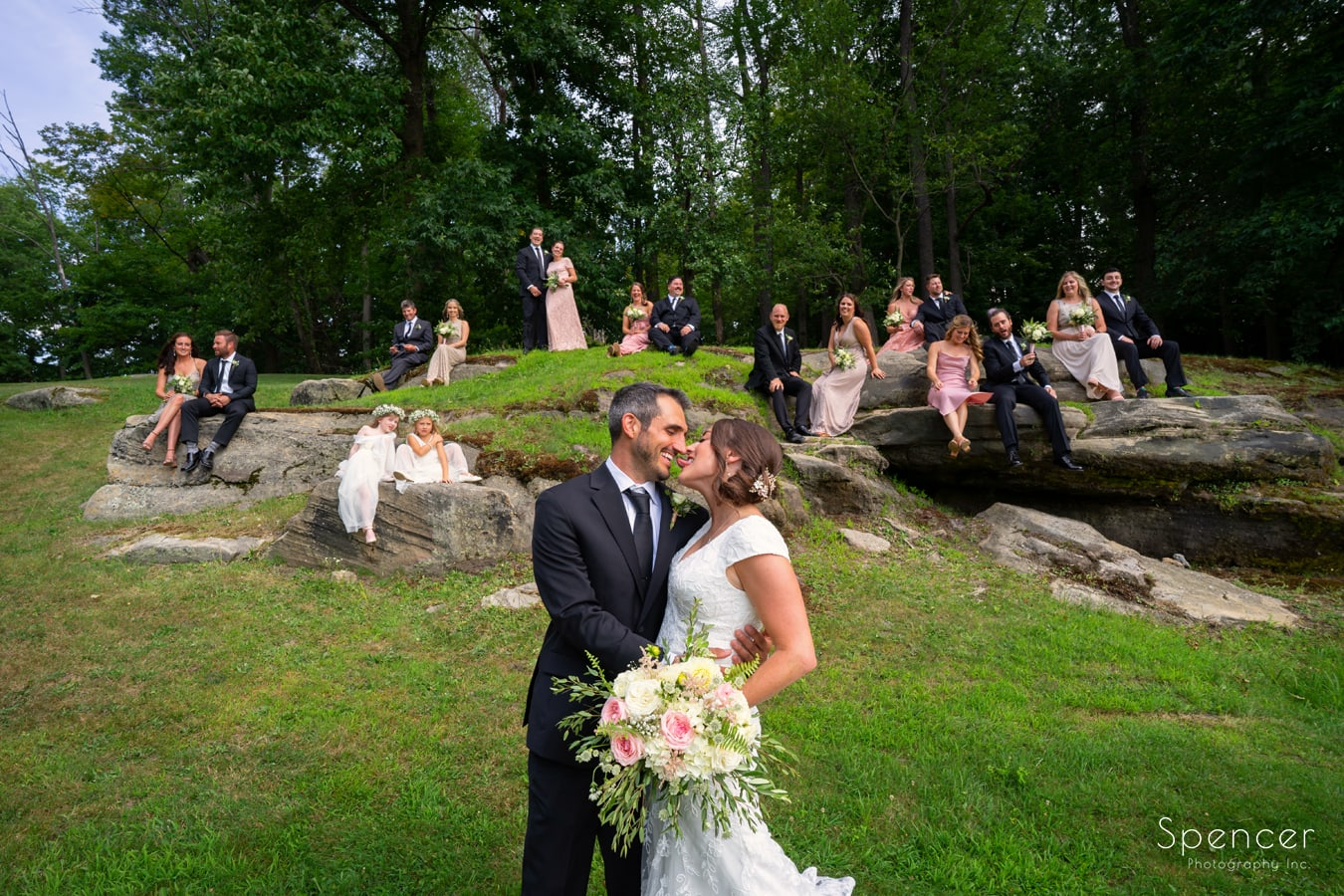 bride sticking out tongue on rocks at Patterson Fruit Farm