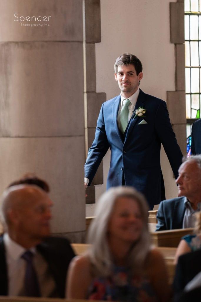 groom walking to aisle