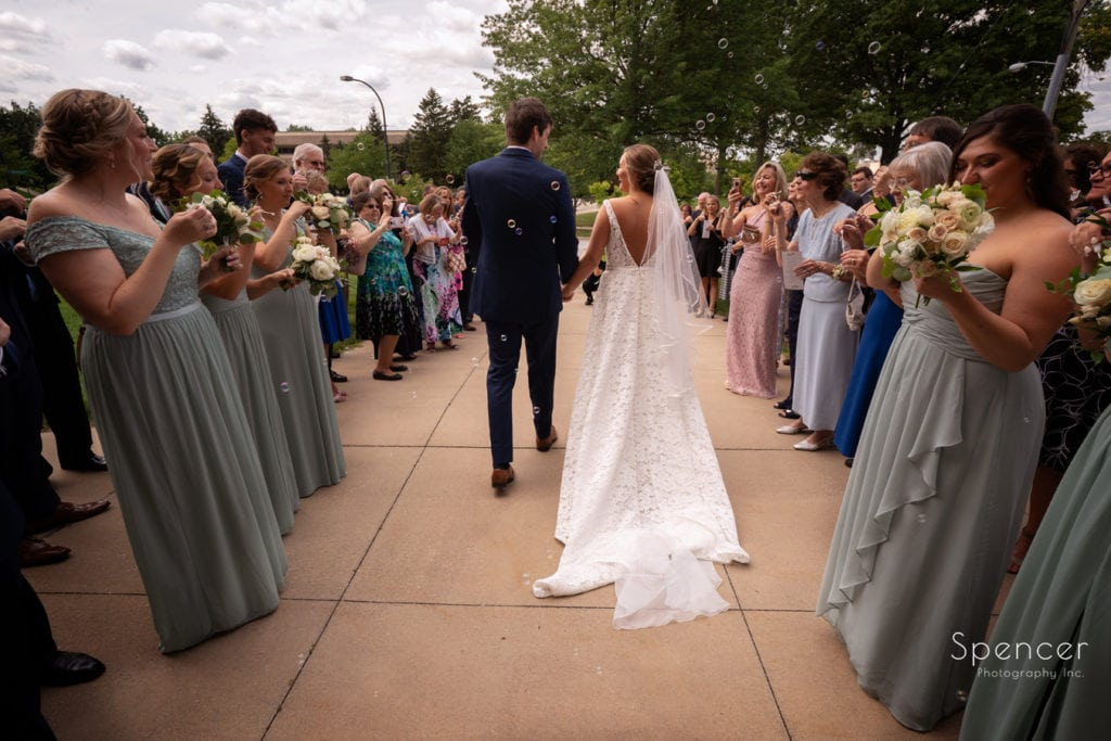 bride and groom exit The Chapel Akron