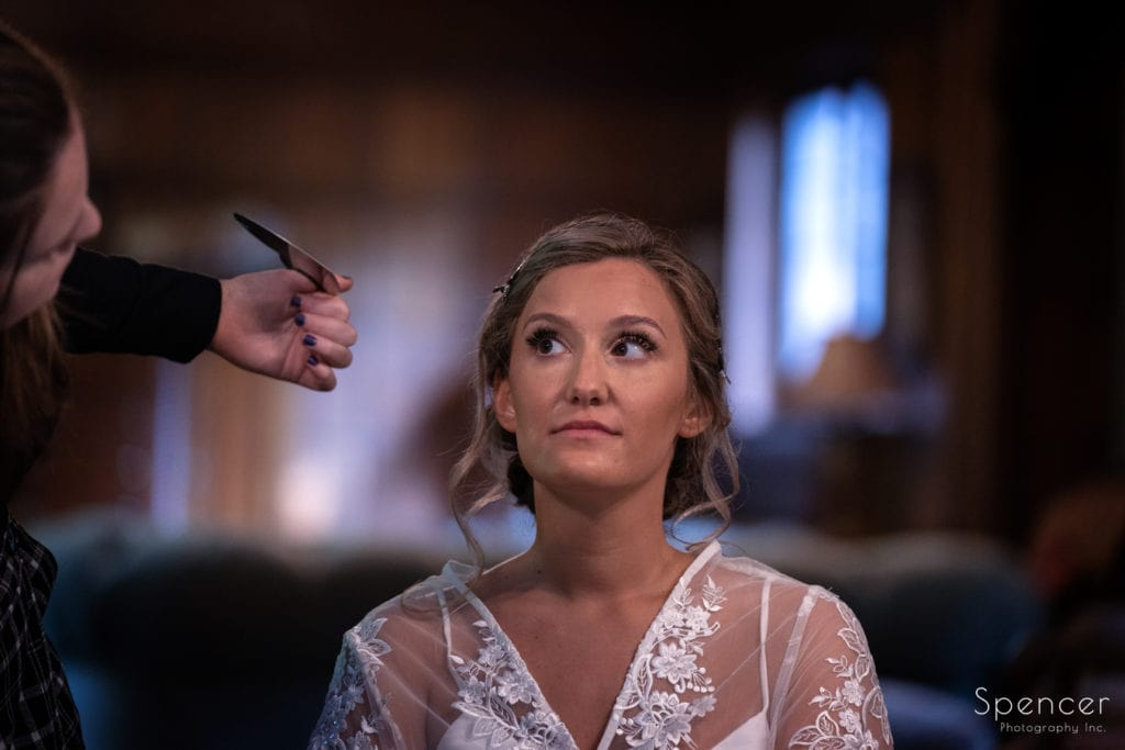 bride looking at make-up artist at O'Neil House Akron