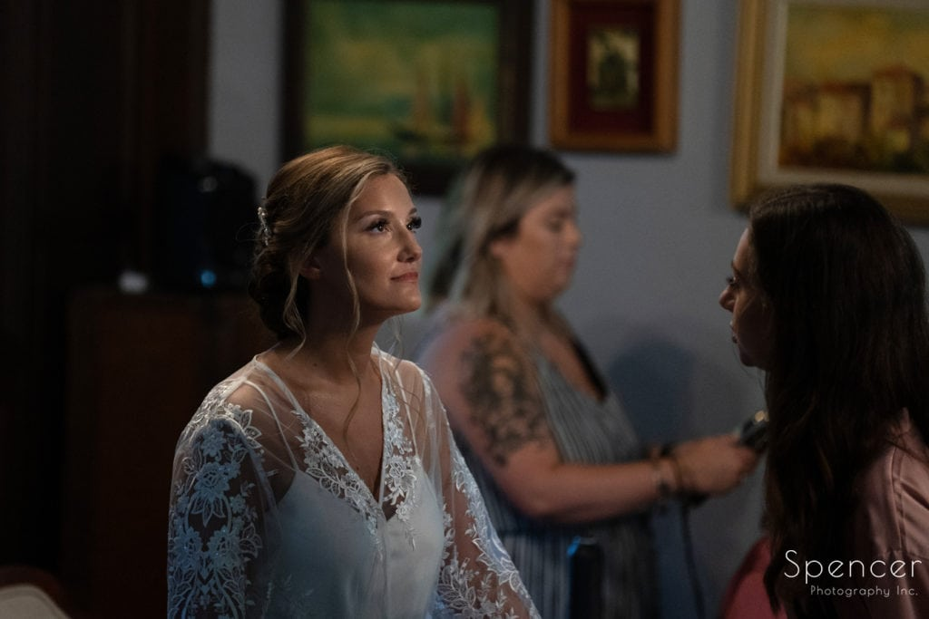 the bride consulting with bridesmaid