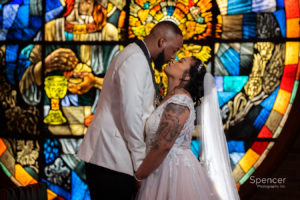 bride and groom kissing after wedding at St Leo the Great Cleveland