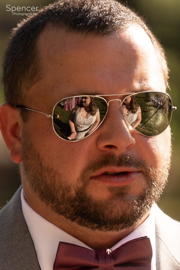 reflection fo bride in grooms sunglasses
