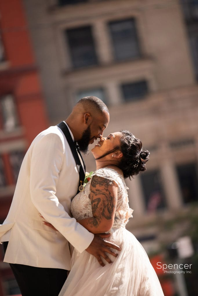 bride and groom kissing in downtown Cleveland