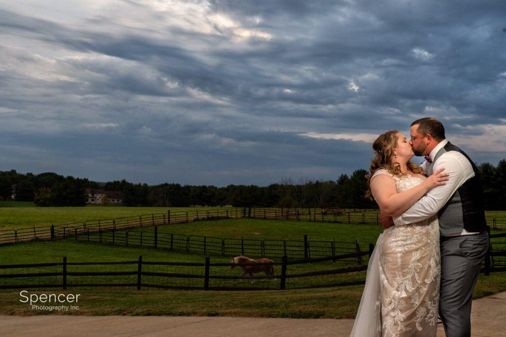bride and groom kissing at Parker Barn Wedding