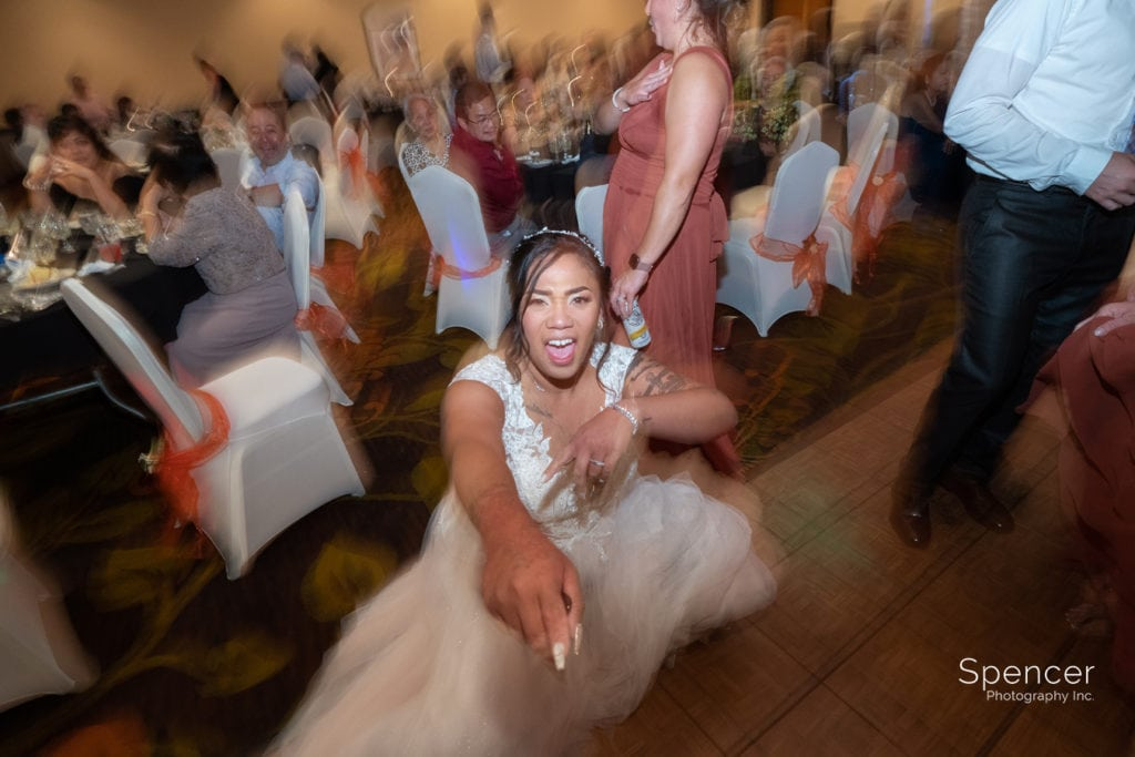 bride dancing at her Cleveland Doubletree reception