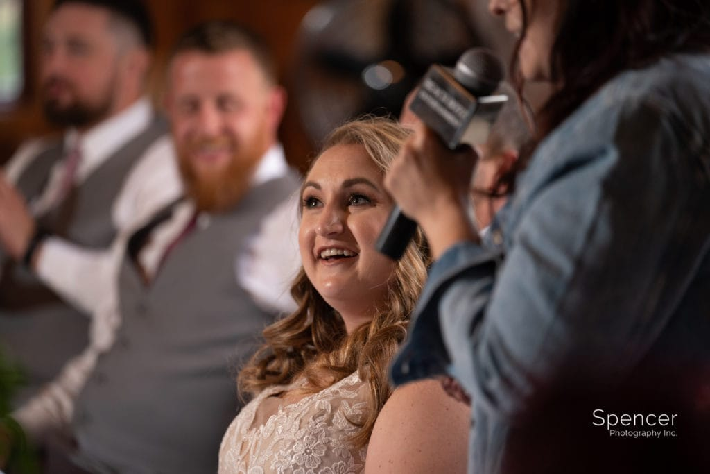 bride reacting to maid of honor speech
