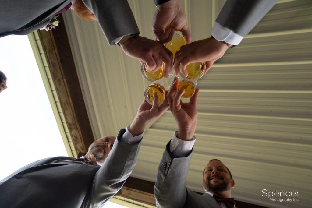 groomsmen having drink at Parker Farm