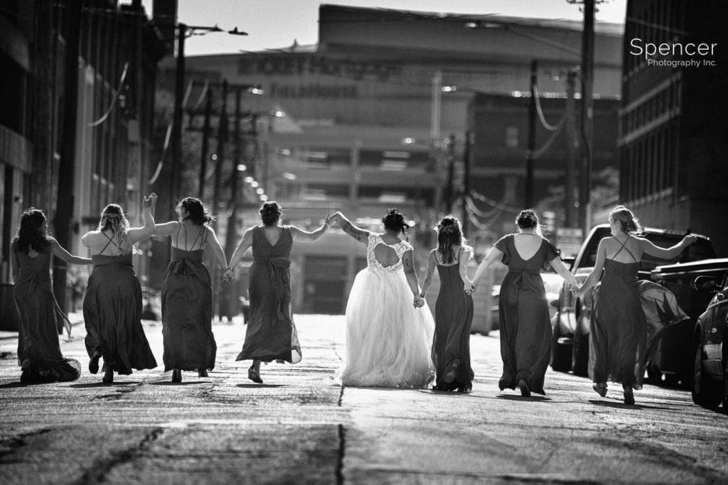 bridesmaids walking down cleveland street with bride