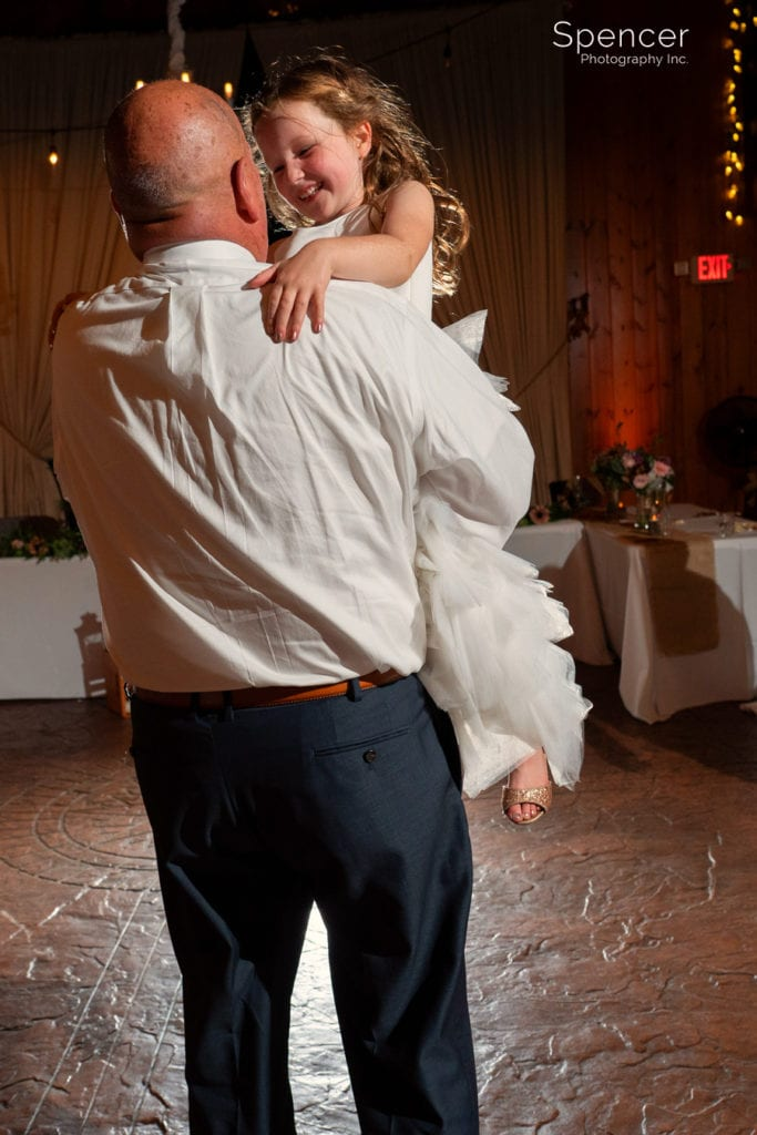 flower girl dancing with grandpa