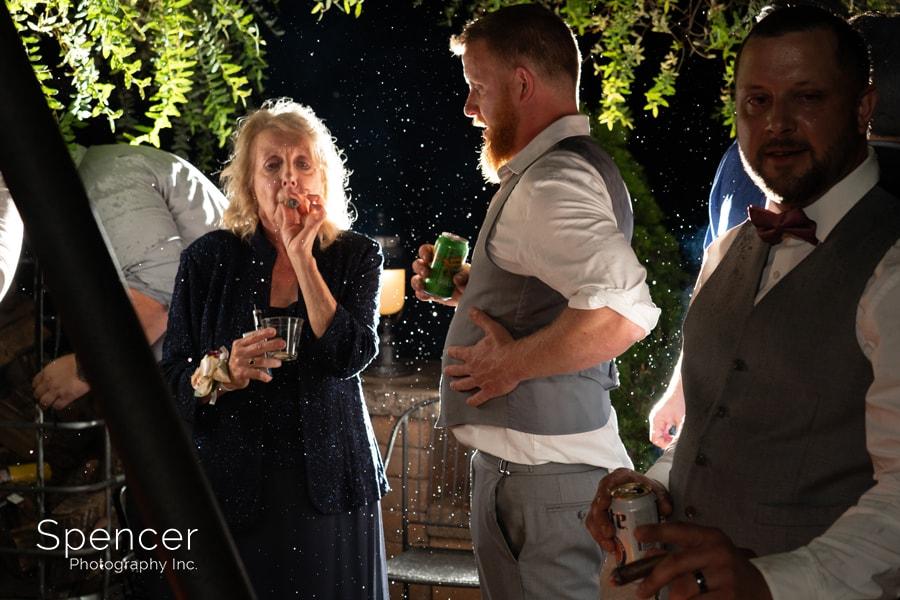 mother of groom smoking cigar