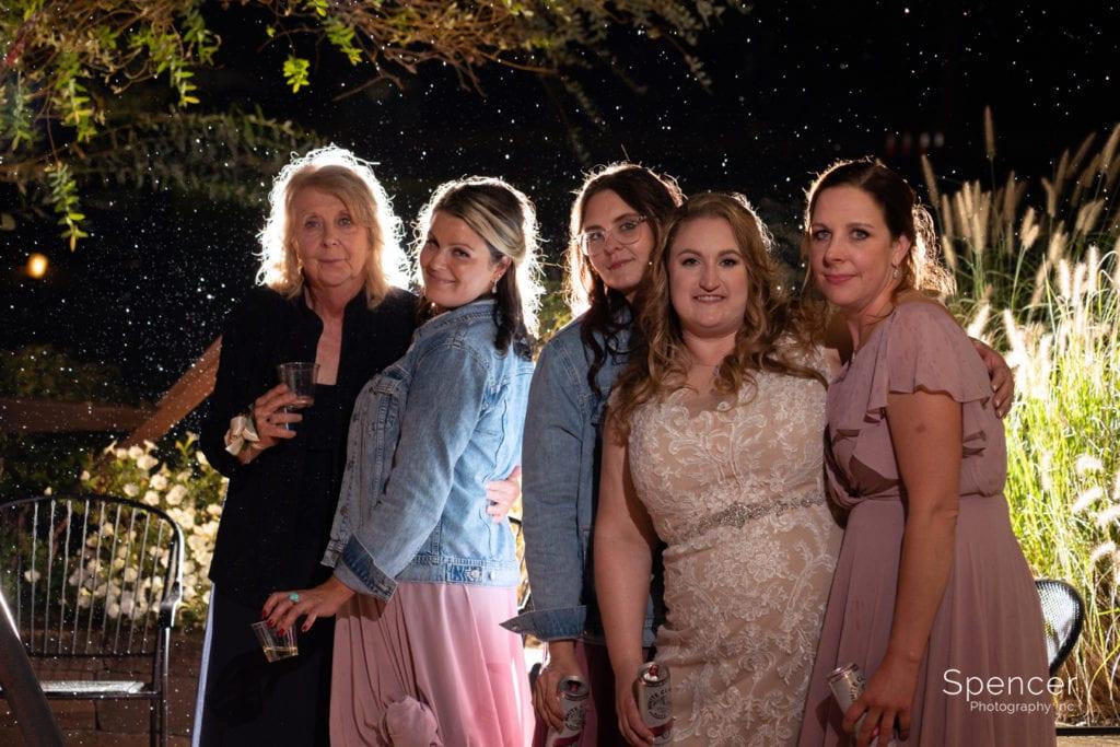 bridesmaids after wedding reception