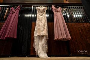 wedding dresses hanging in Parker Barn